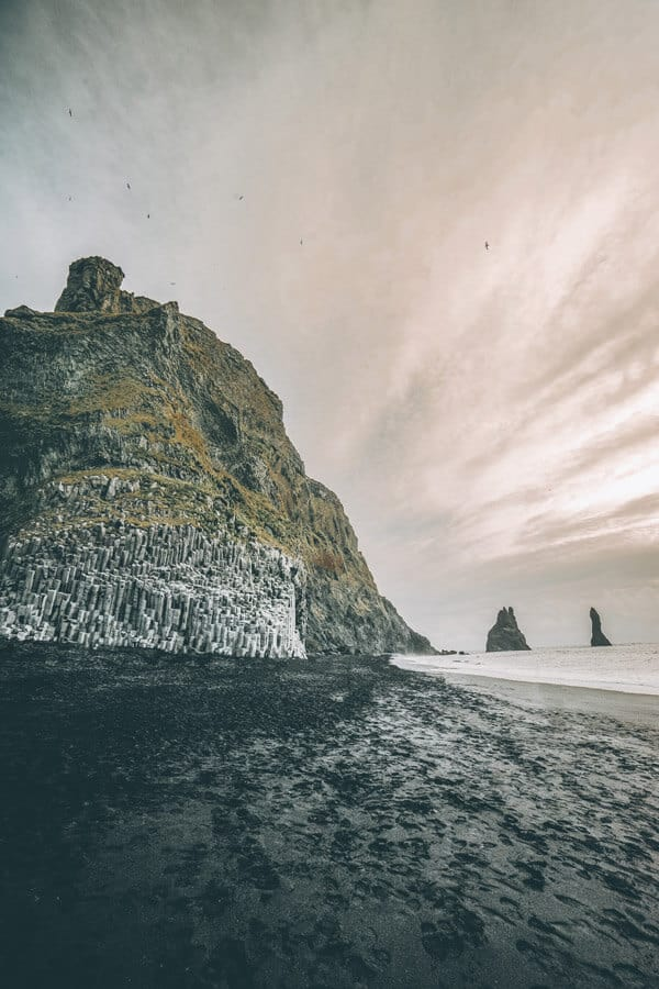 Reynisfjara Basalt Columns.  Things to do and see in Vik Iceland! Visiting the black sand beach is at the top of the list. It was truly unlike anything I have every seen before. Whether you are traveling to Iceland in the winter or summer you will not want to miss a trip to Vik.  #vik #iceland