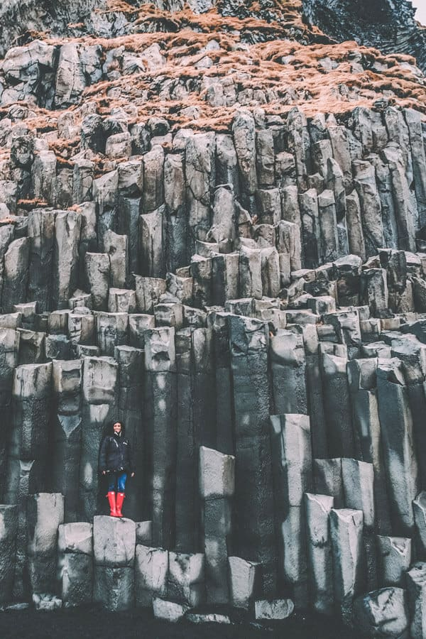 Reynisfjara Basalt Columns in Vik Iceland! Things to do and see in Vik Iceland! Visiting the black sand beach is at the top of the list. It was truly unlike anything I have every seen before. Whether you are traveling to Iceland in the winter or summer you will not want to miss a trip to Vik.
