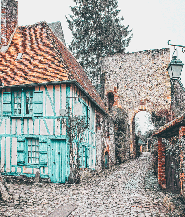 Fairytale Places that Really Exist like this beautiful village in France! This charming small town in France is a popular tourist attraction will not disappoint you on your vacation in Europe! Click to avenlylane.com to see 15 of the most beautiful fairytale travel destinations in the world! #wanderlust #france #traveltips #europe #bucketlist #travel #villages #travelmore #castles #portugal #traveling #palace #roadtrip #avenlylane #avenlylanetravel