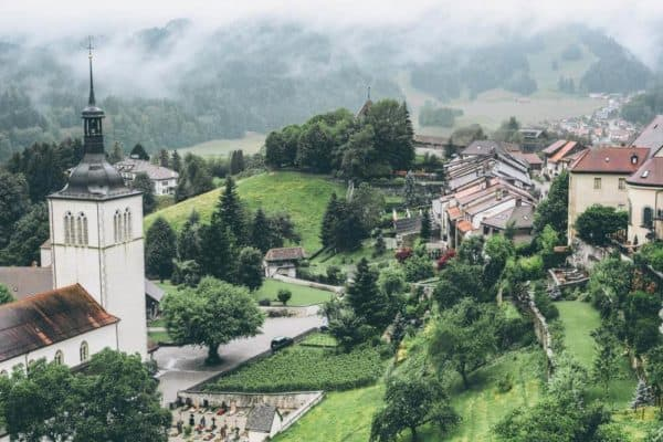 15 prettiest towns in Switzerland! Aerial view of the Swiss town, Adelboden. One of the top things to see in Switzerland! If you are planning a road trip through Switzerland you do not want to miss these small towns! #avenlylanetravel #avenlylane #switzerland #europebucketlist #travel