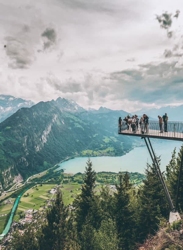 Interlaken, Switzerland, one of the The 15 Prettiest Towns in Switzerland. If you are planning a vacation in Switzerland you HAVE to visit these 15 top places in Switzerland. They are incredible! See 14 others on www.avenlylane.com #avenlylanetravel #avenlylane #travelinspiration #travel #beautifulplaces #europe #switzerland