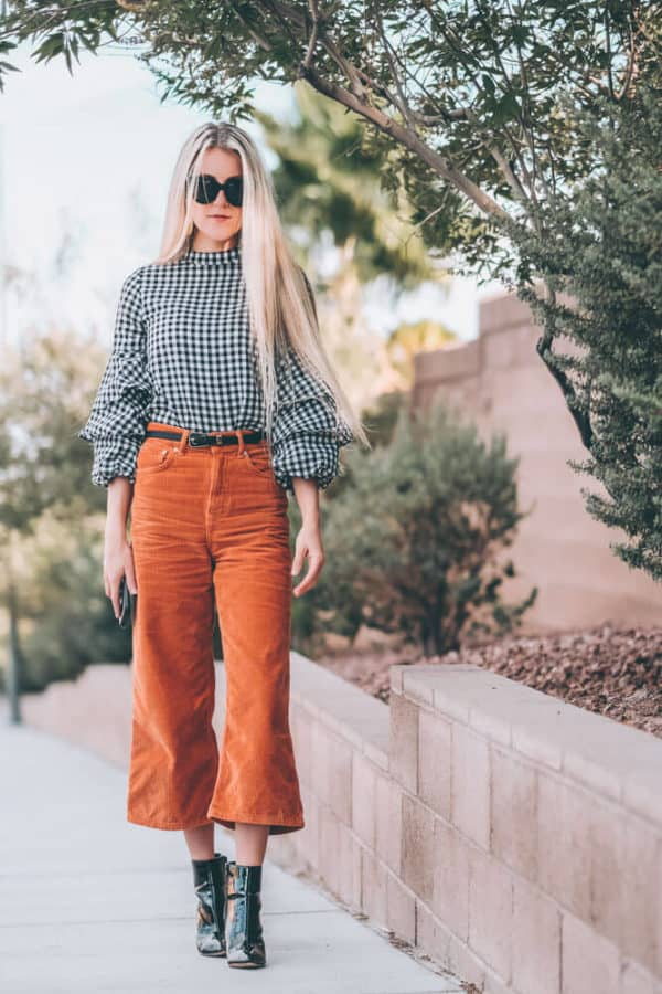 Fall Fashion Trends: Corduroy Culottes. This is one of the must have fall fashion items of the season. They are so flattering on so many different body types and super comfortable. Have you guys tried them? Check out the post and let me know if you would wear them! | www.avenlylane.com #fashion #avenlylane #avenlylanefashion #fallfashion #ootd #falloutfits #falloutfit #boots #booties #culottes #falltrends #fashiontrends