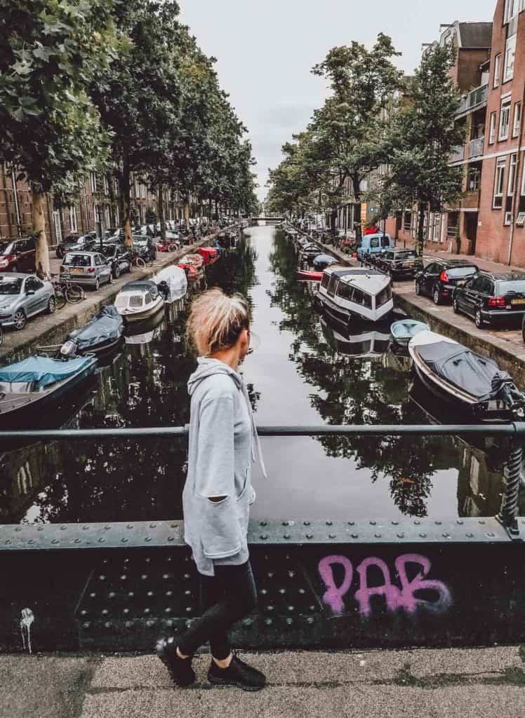 Top 8 places to visit in the Netherlands! There are so many fun things to do in Amsterdam and the canals are just one of them! This gorgeous city features over 50 miles of manmade canals with over 1500 bridges crossing over them. #AVENLYLANETRAVEL #AVENLYLANE #netherlands #amsterdam #beautifulplaces #travelinspiration #europe